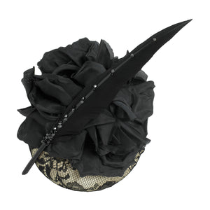 neutral and black lace pillbox fascintor wedding hat with large black silk flower and sharp black feather with crystals