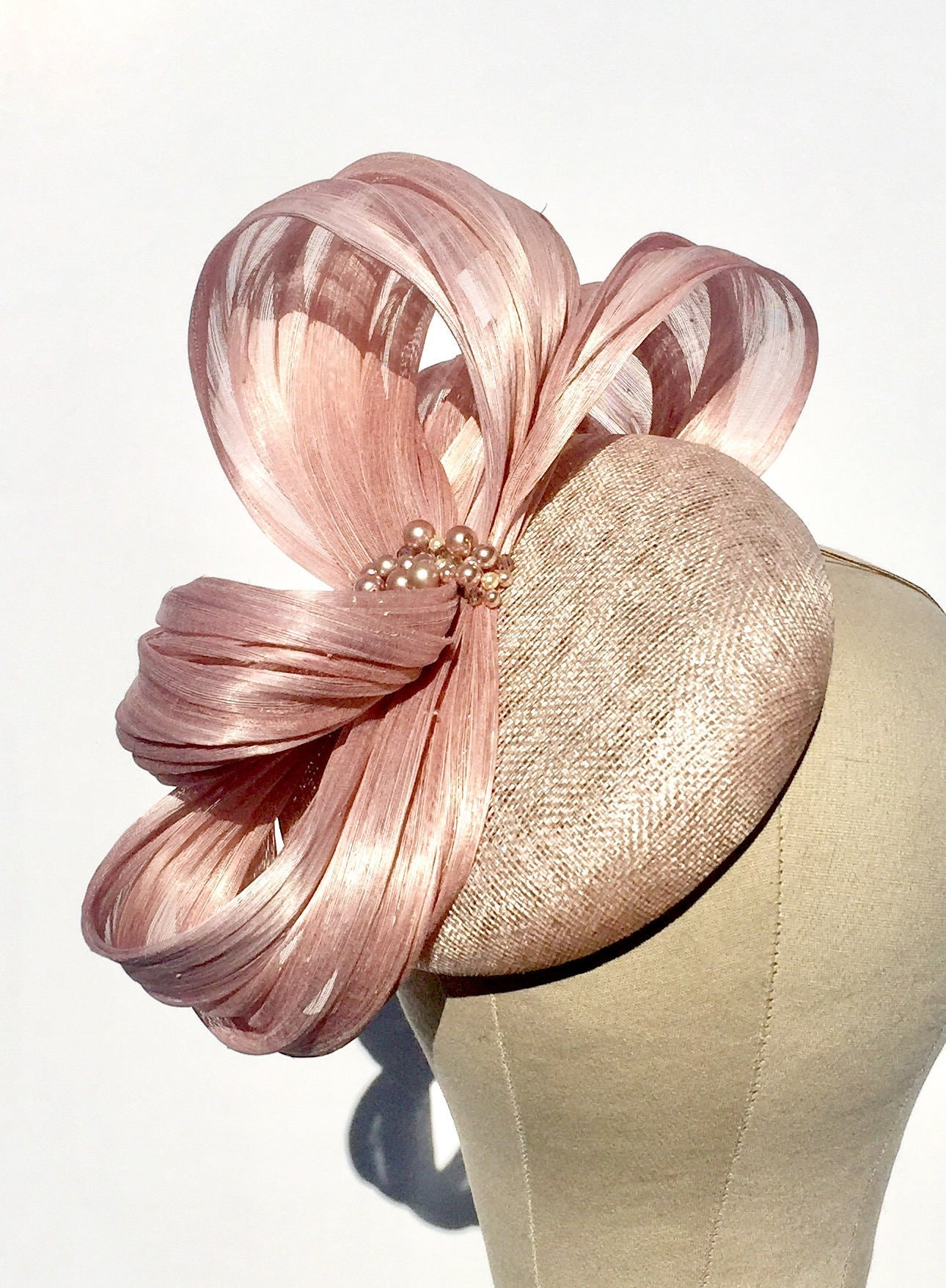 blush pink fascinator pillbox hat, ideal for wedding guests or royal ascot
