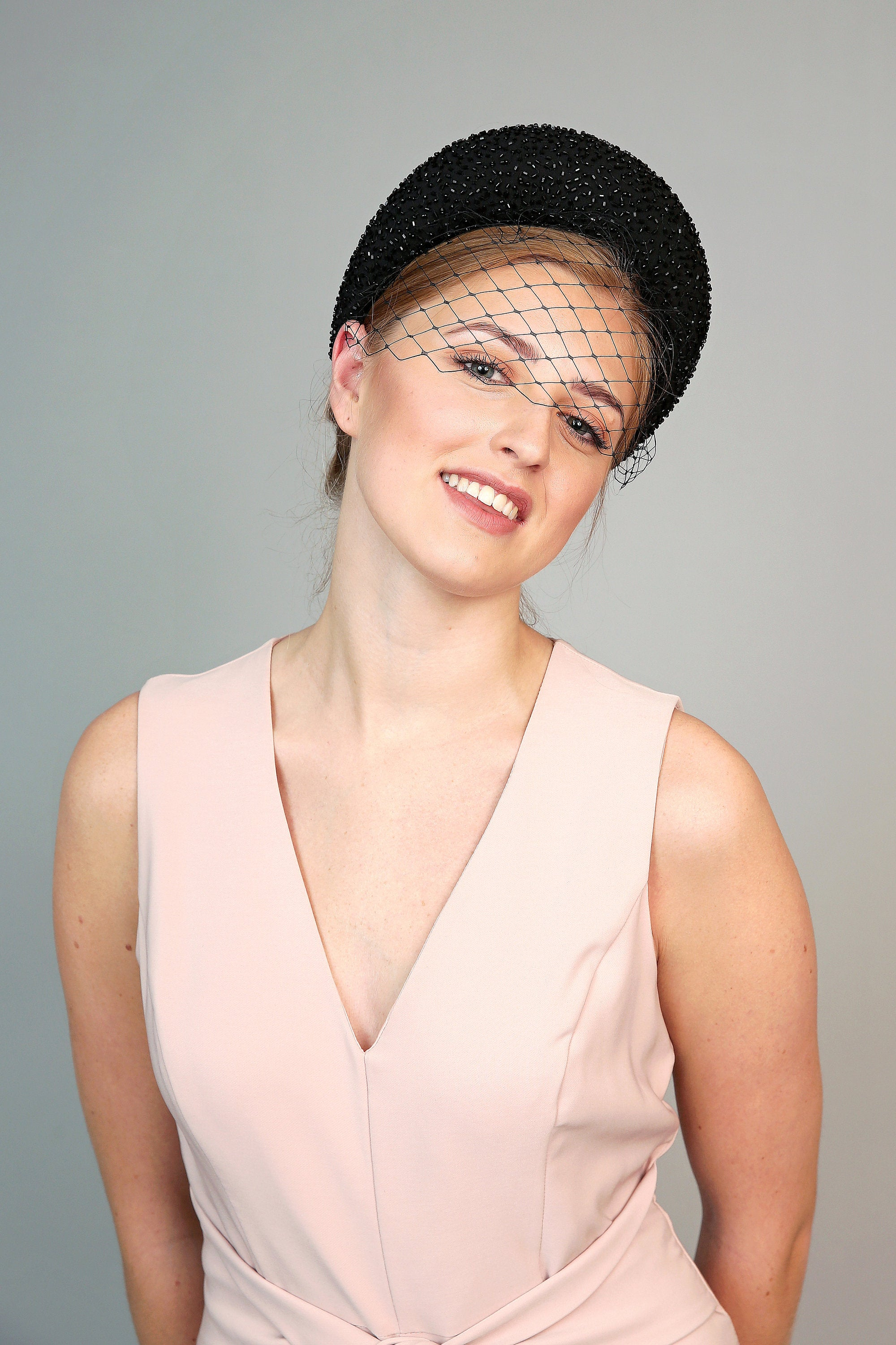 black crystal padded headband in the style of kate middleton, perfect for royal ascot or wedding hat