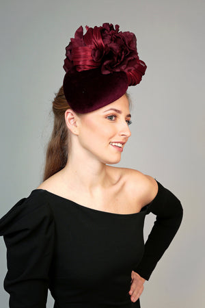 burgundy velvet teardrop fascinator hat, ideal for winter weddings, with large silk flower and silk abaca loops