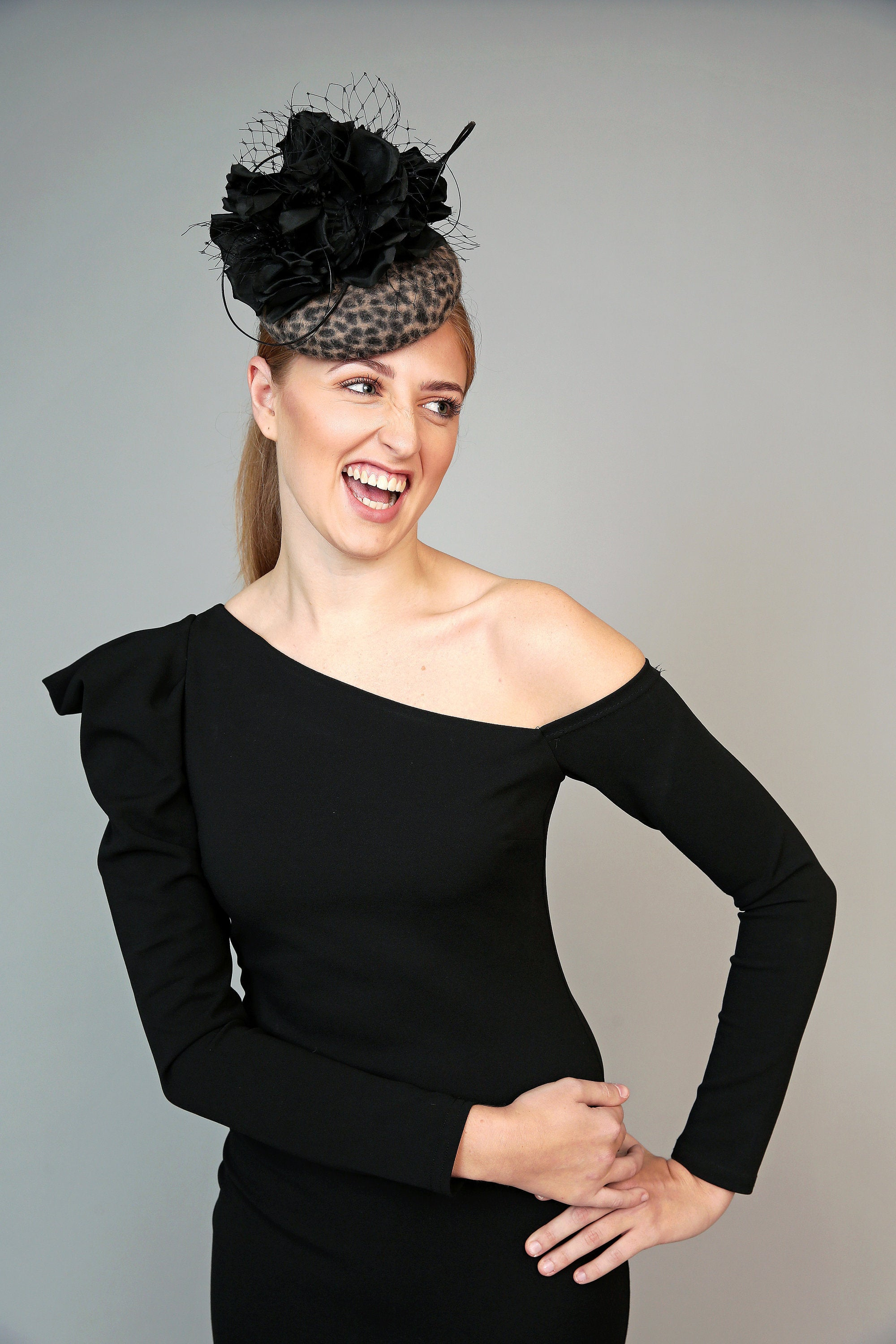 leopard animal print pillbox fascinator hat with large black silk flower, veiling crystals and quills