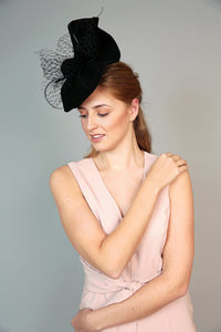 black handshaped wave fascinator felt winter wedding hat with veiling and quills