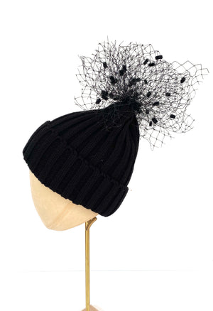black knitted beanie bobble hat with pom pom veiling