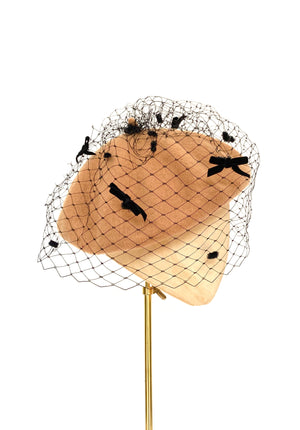 camel coloured beret with black veiling and velvet bows