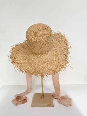 natural wide brim straw hat with ballet pink ribbon ties