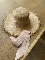 wide brimmed sun hat natural straw with long ribbons