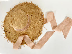 floppy straw sun hat with pink ribbon