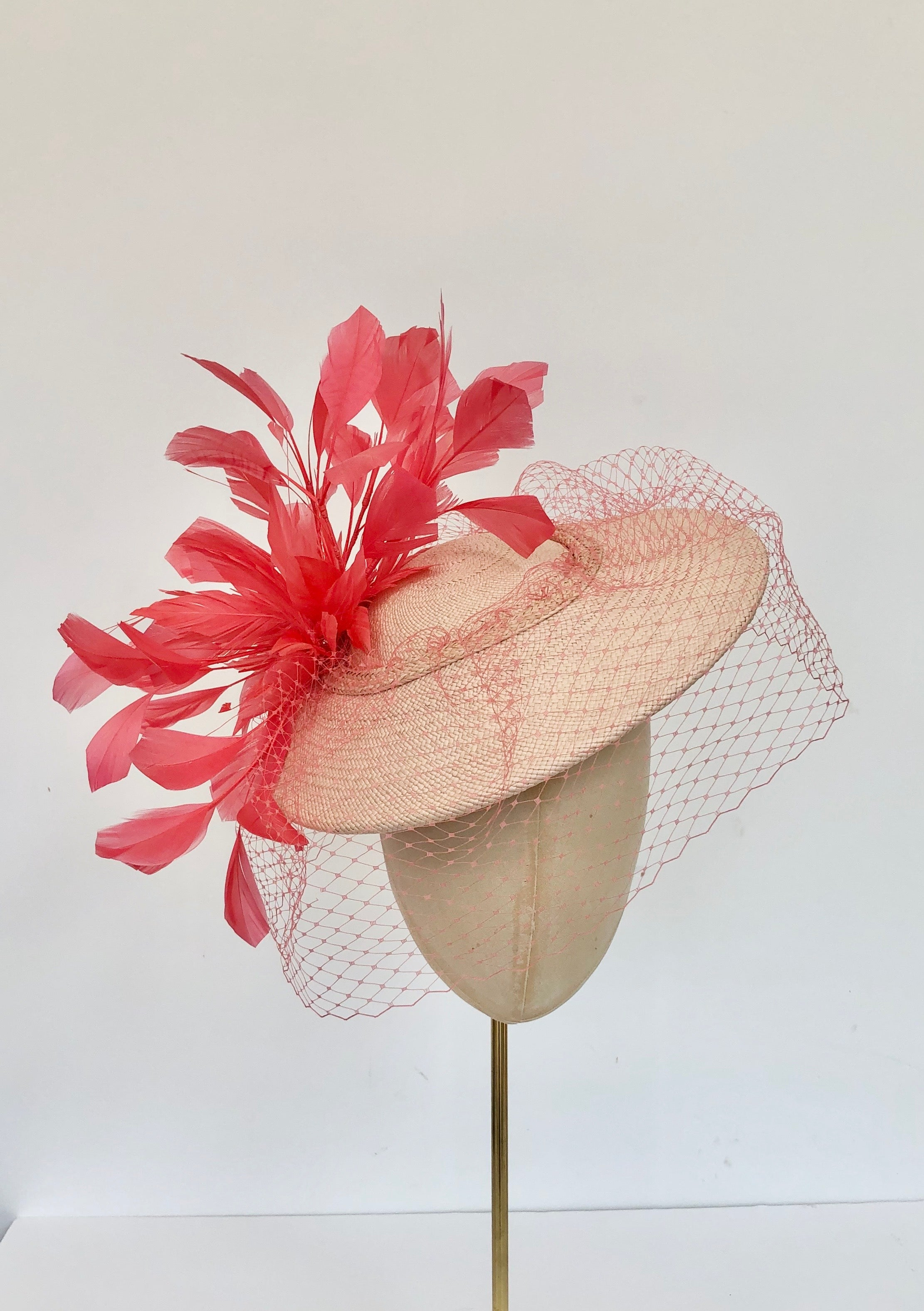coral and peach panama disc saucer fascinator hat with coral feather spray and coral veiling