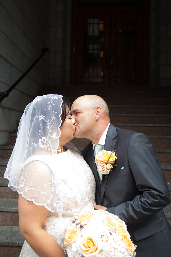 Maria Olaguera Forlini and Danny Forlini kiss at their intimate Filipino and Italian wedding in Montreal.