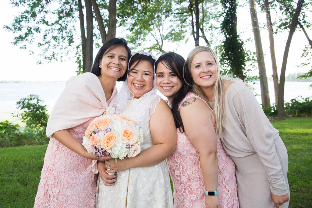 A Filipina bride with her three bridesmaids at her Filipino and Italian wedding in Montreal