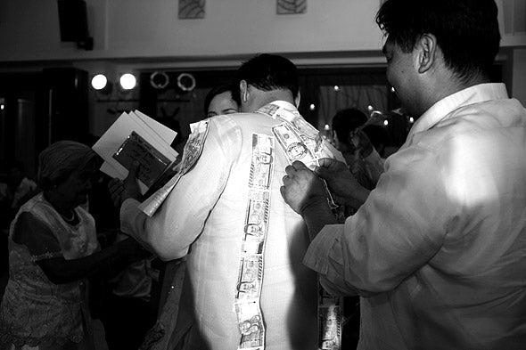 A natural concern for brides and grooms about the money dance is how to preserve their wedding gown and barong amid all the pins.