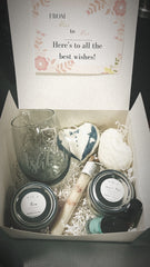 bridal gift box filled with personalized glass, two bath bombs, two exfoliants, a bath salt tube and two small beauty products