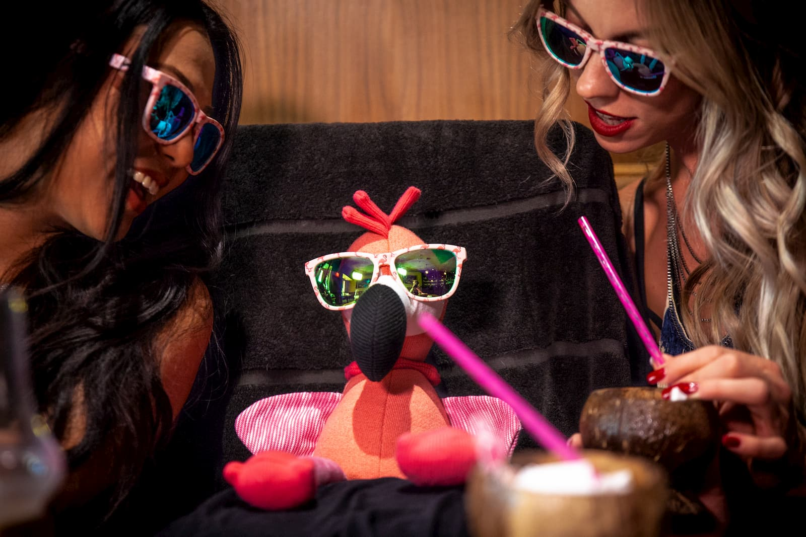 girls wearing goodr running sunglasses on a date with flamingo CEO Carl
