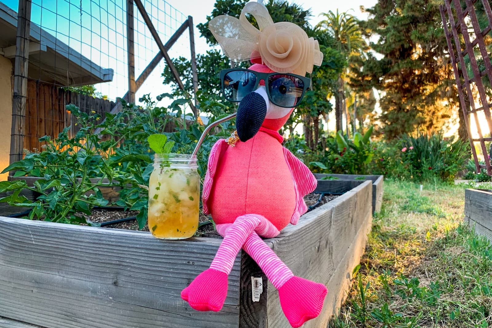 Carl the Flamingo CEO at the Kentucky Derby drinking mint juleps