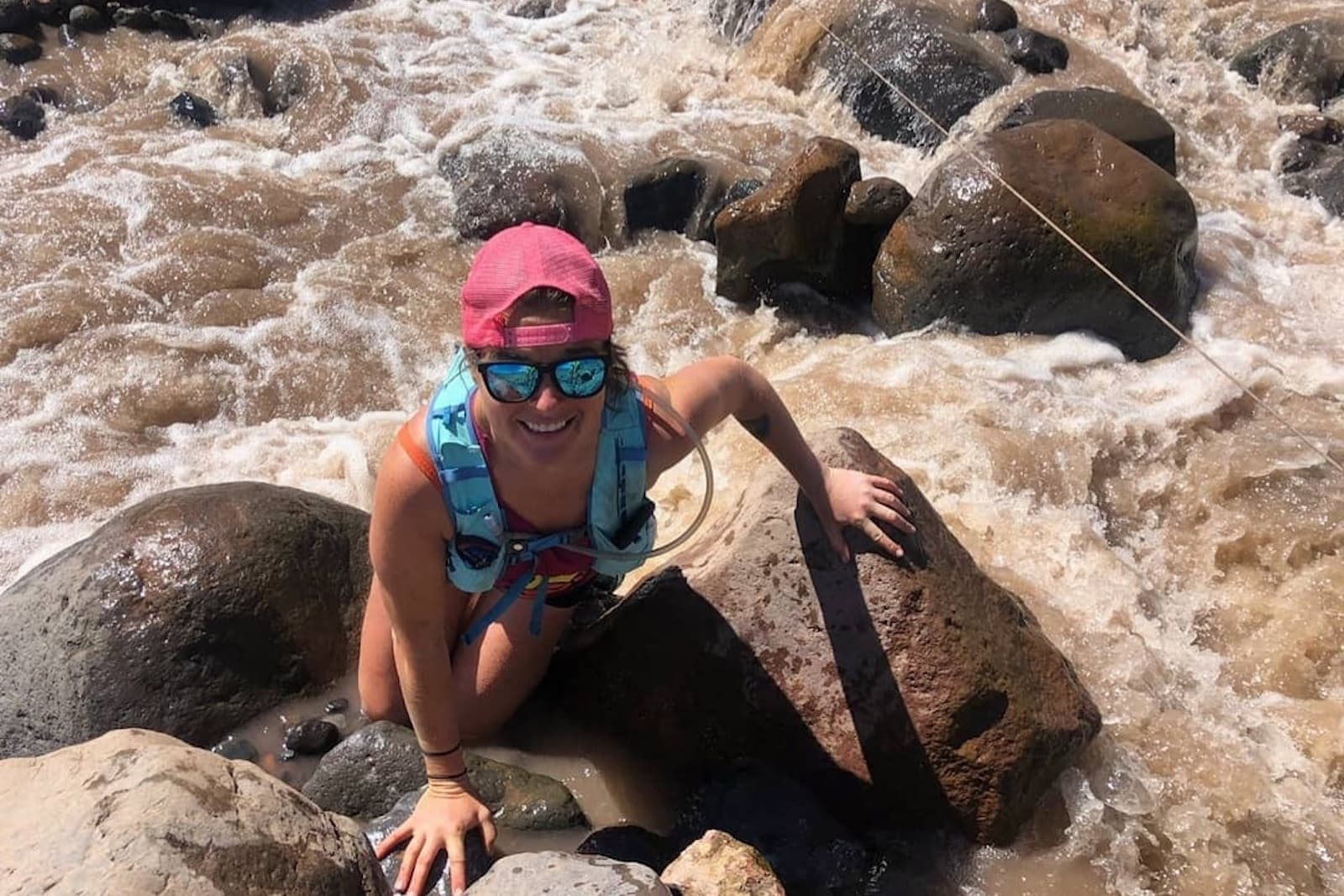Emily Halnon hiking with goodr running sunglasses