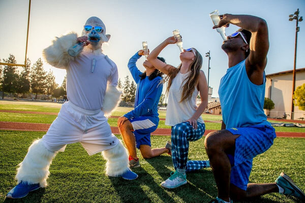Runners drinking on the track while wearing white sunglasses with blue mirrored lenses