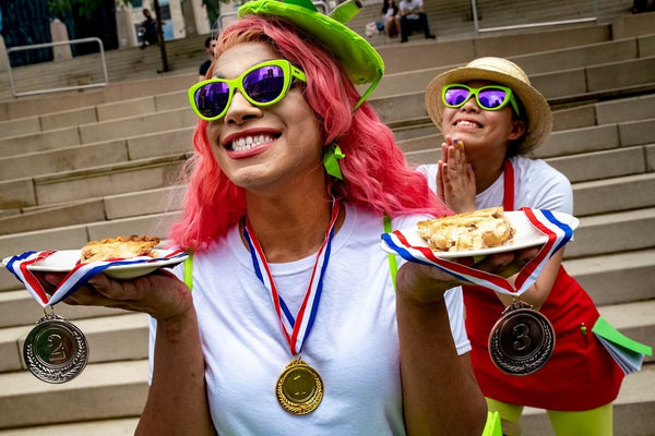 Lime green cateye sunglasses at a pie contest