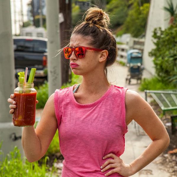 girl in red sunglasses drinking bloody mary