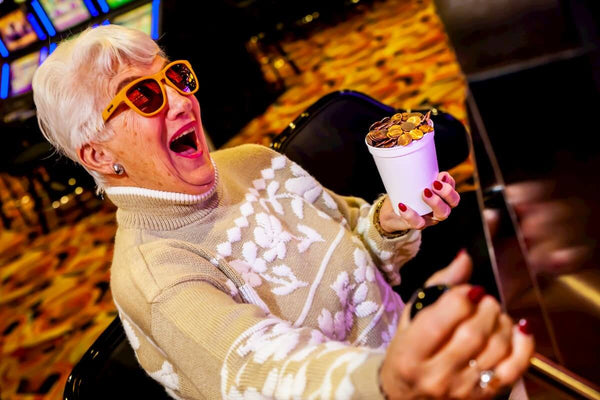 goodr yellow sunglasses on older lady playing slot machine
