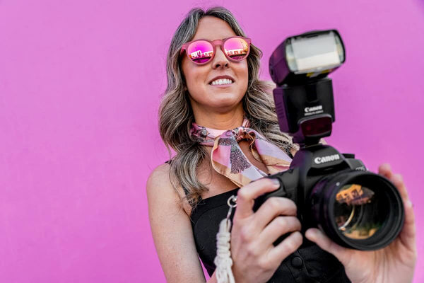 girl wearing pink hipster sunglasses with mirrored lenses