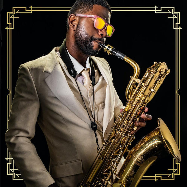 man playing sax in goodr polarized sunglasses