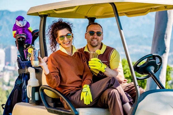 man and woman wearing golf sunglasses
