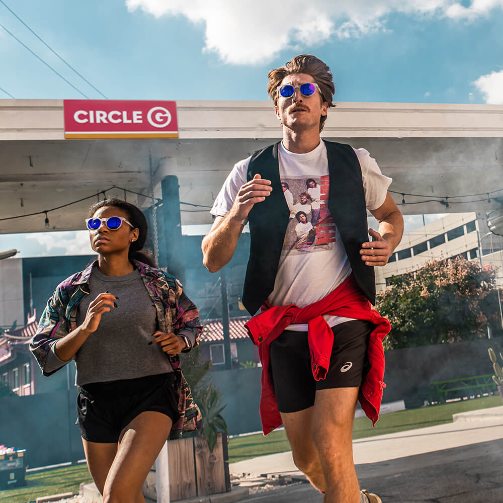 running sunglasses round clear frame mirrored lenses on man and woman
