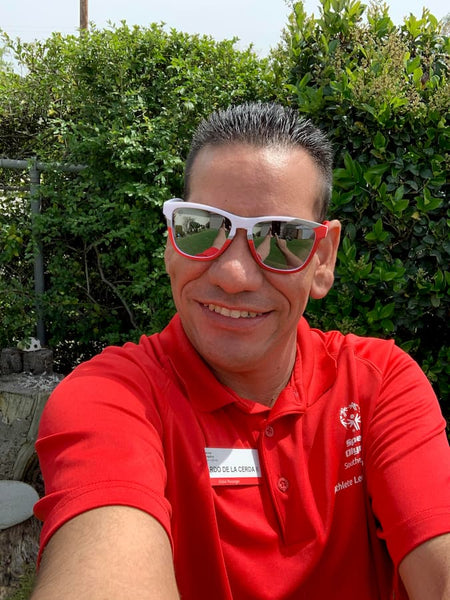 awesome athlete in goodr red and white Special Olympics sunglasses