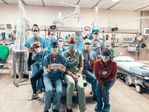 hospital workers in goodr clear lens sunglasses