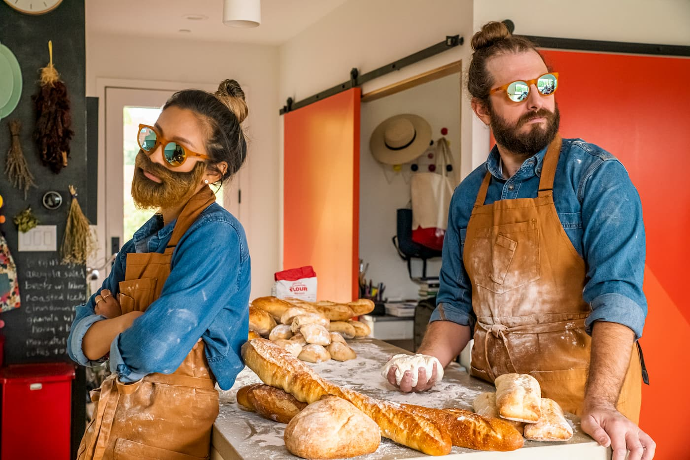 Yellow round mirrored sunglasses on man and woman baking bread