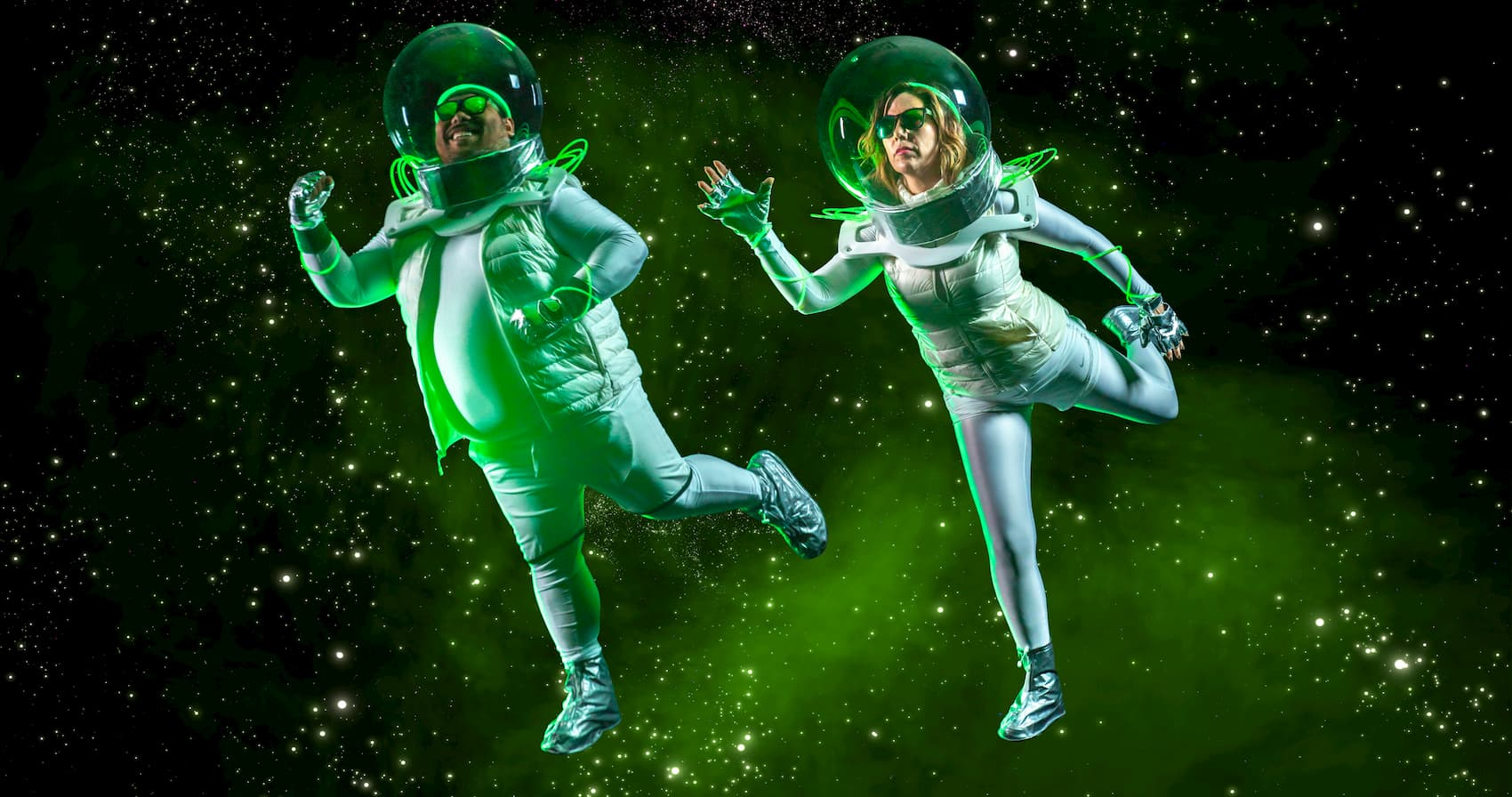 Man and woman running in space with sunglasses on