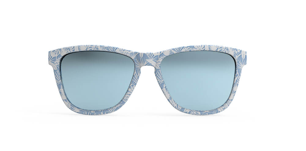 Front view blue frames with all over palm leaf print and blue lens sunglasses with polarized, uv protection, and reflective lenses