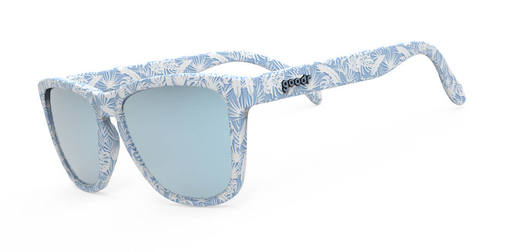 Side view blue frames with all over palm leaf print and blue lens sunglasses with polarized, uv protection, and reflective lenses