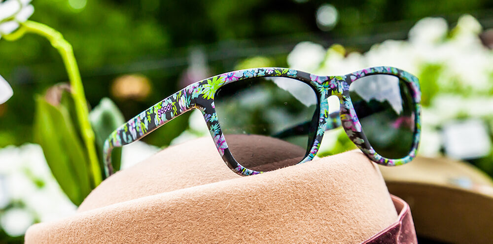 Photo of black frames with all over flower print sunglasses and polarized UV protection mirrored lenses