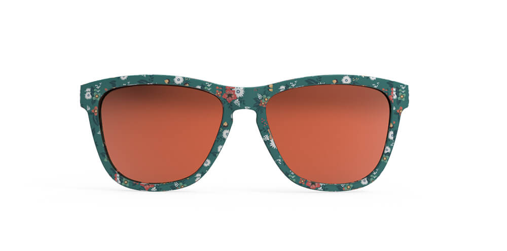 Front view of green framed sunglasses with all over flower print and polarized burnt orange UV protection mirrored lenses