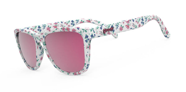 Side view for multi colored floral print on white wayfarer style sunglasses with pink polarized uv protection and mirrored lenses