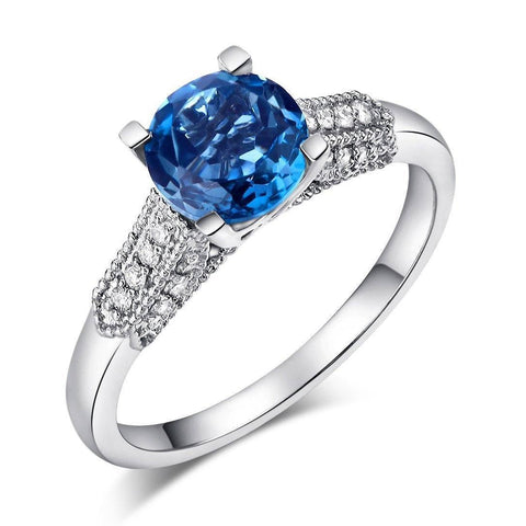 Swiss Blue Topaz (9.65ct) Ring in 14k White Gold with Diamonds (0.1ct)