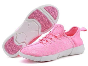 GloKix light up shoes for adults and kids displaying the pink pair on white background