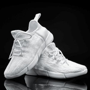 GloKix light up shoes for adults and kids displaying the white pair on black background