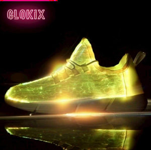 GloKix logo showing white light up shoes glowing yellow with a small reflection