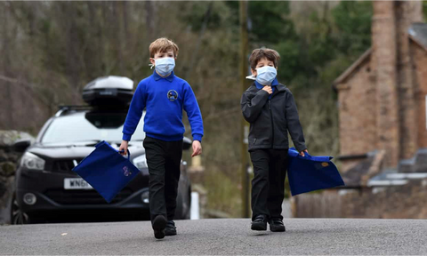 Children walking to school wearing smog pollution masks in Britain. Residents in many developing countries are exposed to toxic air both outdoors and inside their homes. Photograph: David Bagnall/Alam