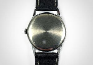 Back of Sunburst dial subseconds vintage luxury watch with sweep seconds hand made by Cyma