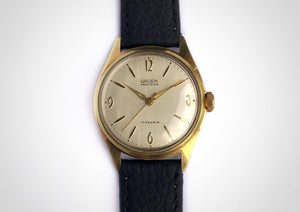 Vintage watch with linen dial and 3-6-9 pattern and gold case made by Gruen. First watch worn by James Bond as Sean Connery