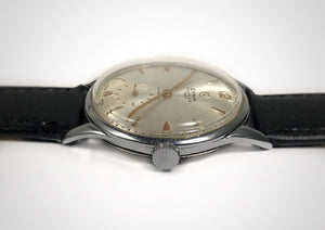 Side view of Sunburst dial subseconds vintage luxury watch with sweep seconds hand made by Cyma