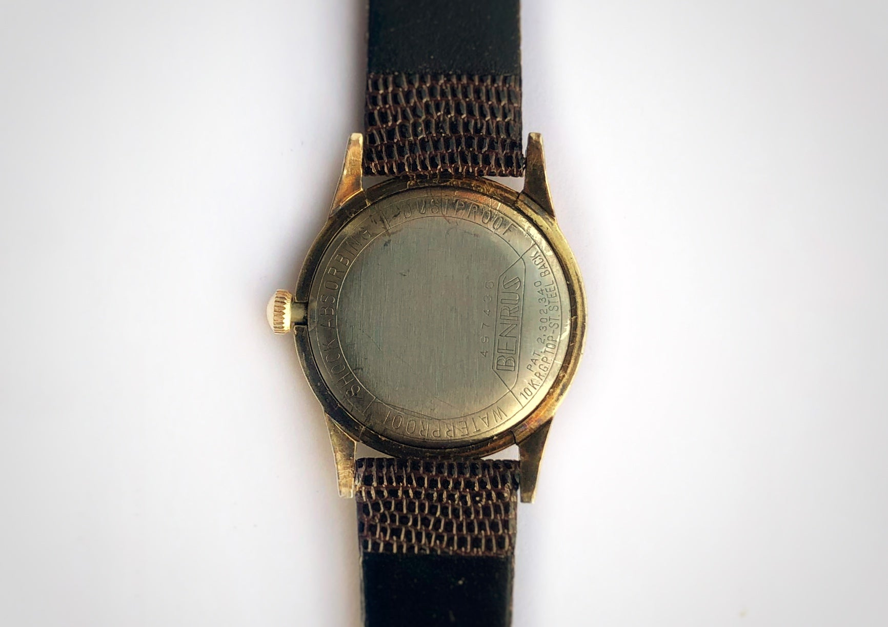 Back of Affordable vintage luxury watch with gold case and tropical dial made by Benrus with engraved caseback