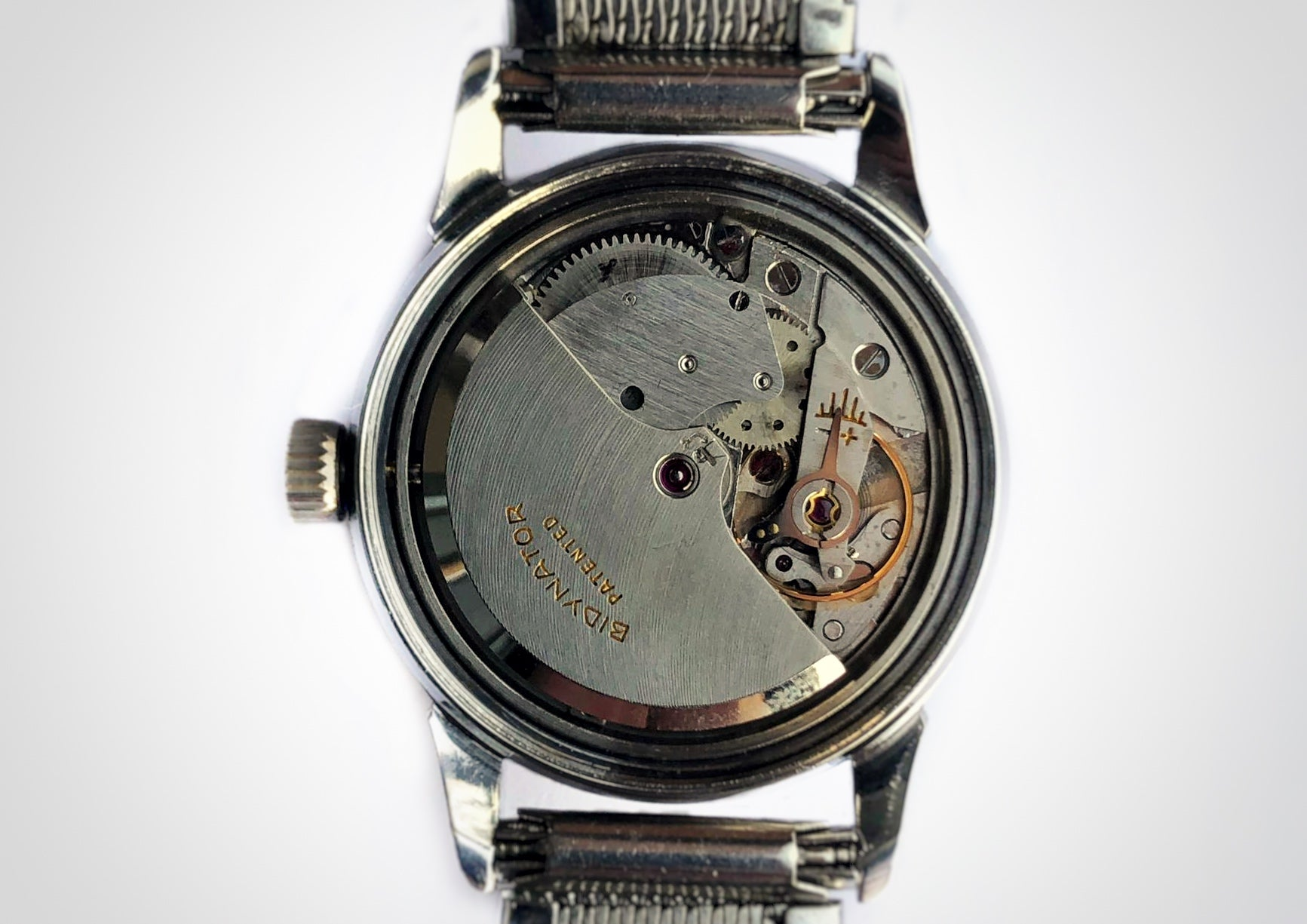 Movement picture of Stainless steel vintage luxury watch with blued indices, made by the brand Beyer. Rotor for automatic winding is visible, bidynator is written on rotor