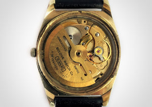 Automatic winding movement with rotor of Gold and black vintage luxury dive watch with stick hands and sweep seconds made by Bulova