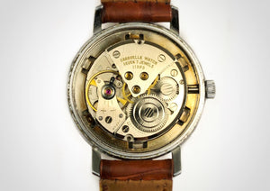 Mechanical, hand wound movement of  Stainless steel vintage luxury watch with 3-6-9 style dial, made by the brand Caravelle by Bulova.