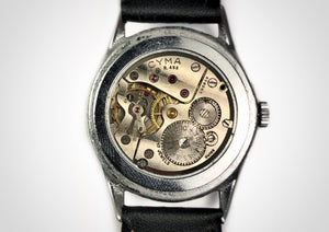 Mechanical, hand wound movement of Sunburst dial subseconds vintage luxury watch with sweep seconds hand made by Cyma
