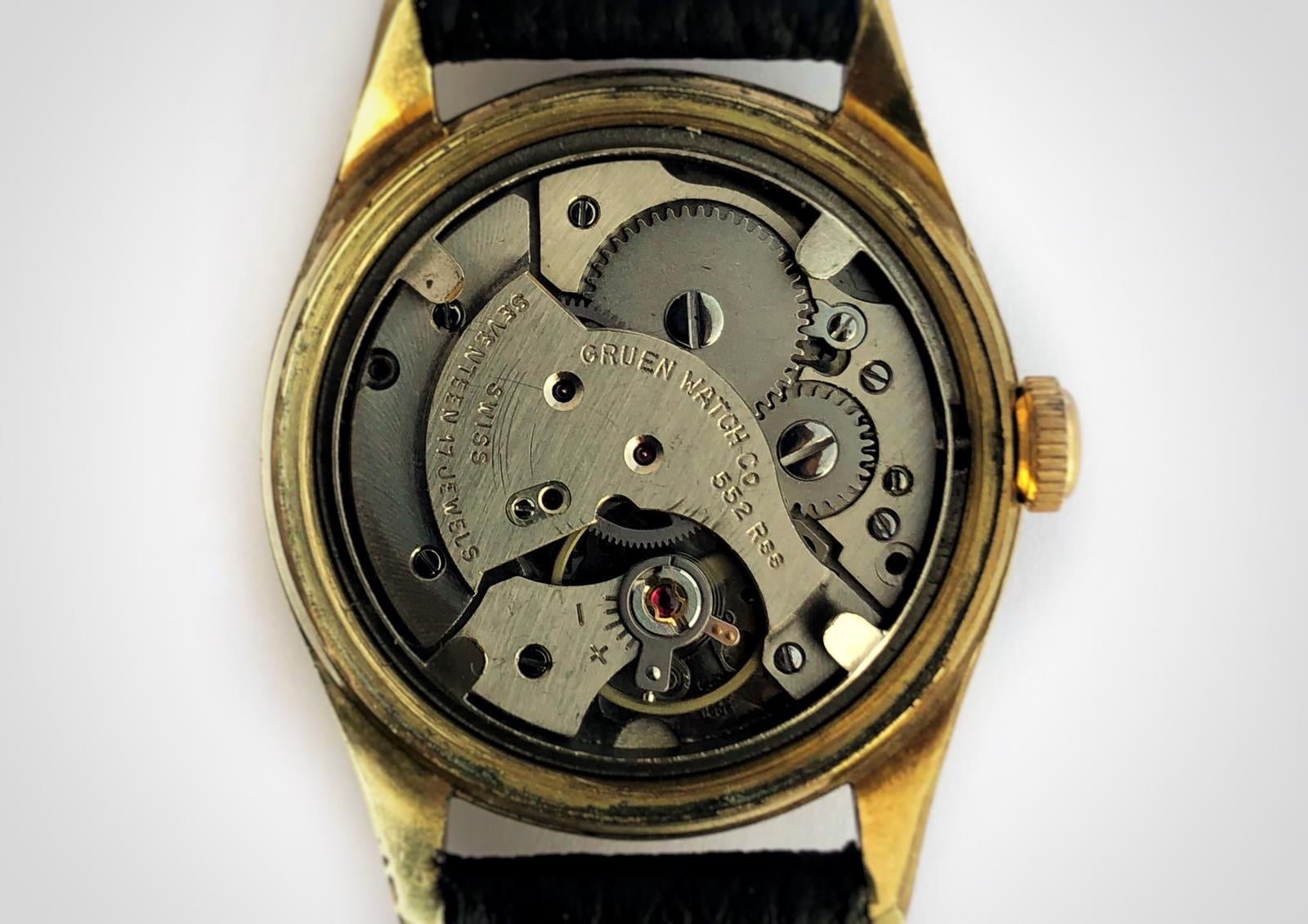 Mechanical hand wound movement of Vintage watch with linen dial and 3-6-9 pattern and gold case made by Gruen. First watch worn by James Bond as Sean Connery